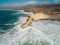 Aerial view of waves crashing of the rocks of punta Guadalupe in Fuerteventura, Canary Island.