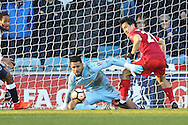 Goalkeeper Jordan Archer of Millwall saves a close range shot from Shinji Okazaki of Leicester City .The Emirates FA Cup 5th round match, Millwall v Leicester City at The Den in London on Saturday 18th February 2017.<br /> pic by John Patrick Fletcher, Andrew Orchard sports photography.