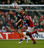 Photo: Richard Lane/Richard Lane Photography. Nottingham Forest v Blackpool. Coca Cola Championship. 13/12/2008. Ben Burgess (L) controls the ball in front of Wes Morgan (R)