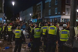 © Licensed to London News Pictures. 19/07/2020. London, UK. Metropolitan police officers engage with the crowd in Notting Hill. A crowd has been dispersed by police from Kingsington Park Road in Notting Hill. The crowd was ordered to leave the area under a Section 35 order. The Crowd were generally compliant and left the area peacefully. Photo credit: Peter Manning/LNP