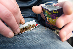 Rolling a joint using tobacco and Happy Joker, a Legal High