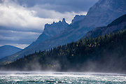 Wind whips up spray on Waterton Lake in Waterton Lakes National Park, Canadian Rockies, Alberta, Canada. In 1932, Waterton-Glacier International Peace Park joined Glacier National Park in Montana with Waterton. UNESCO honored Waterton-Glacier as a World Heritage Site (1995) containing two Biosphere Reserves (1976).