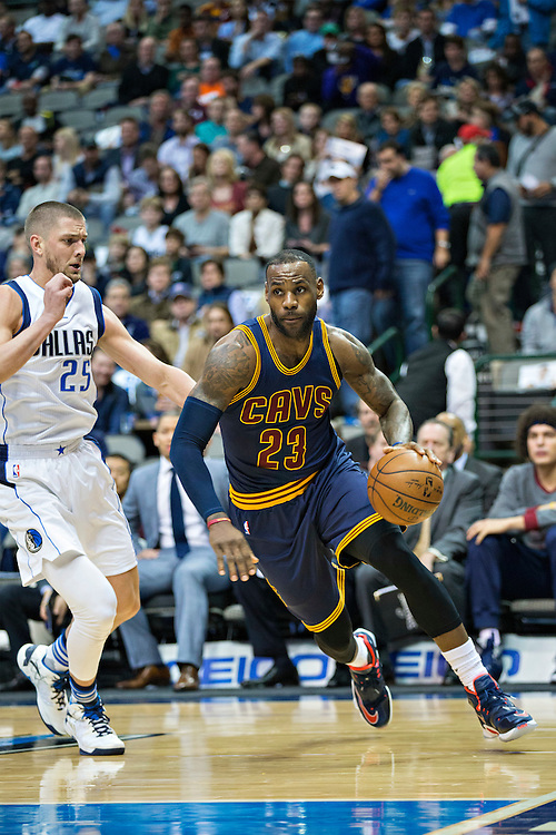 DALLAS, TX - JANUARY 12:  Lebron James #23 of the Cleveland Cavaliers drives to the basket while being guarded by Chandler Parsons #25 of the Dallas Mavericks at American Airlines Center on January 12, 2016 in Dallas, Texas.  NOTE TO USER: User expressly acknowledges and agrees that, by downloading and or using this photograph, User is consenting to the terms and conditions of the Getty Images License Agreement.  The Cavaliers defeated the Mavericks 110-107.  (Photo by Wesley Hitt/Getty Images) *** Local Caption *** Lebron James; Chandler Parsons