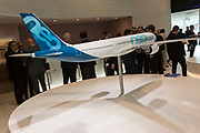 A scale model of the Airbus A330-900 airliner and Airbus employees in the company's hospitality chalet at the Farnborough Airshow, on 18th July 2018, in Farnborough, England.