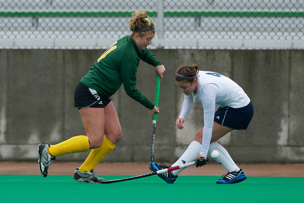 Catamounts midfielder Callie Bellimer (11) battles for the ball during the women's field hockey game between the Maine Black Bears and the Vermont Catamounts at Moulton/Winder Field on Saturday afternoon September 29, 2012 in Burlington, Vermont.