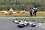 Wurtsboro, NY - With a radio control model plane in the foreground and real aircraft in the background, people point to attractions during the grand reopening of Wurtsboro Airport on May 11, 2008.