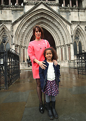 Alina Dulgheriu, 34, a representative for campaign group Be Here For Me, with her six-year-old daughter Sarah, outside the Royal Courts of Justice in London, after filing a High Court challenge against Ealing council over a ban on protesting outside a Marie Stopes clinic.