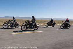 Team Rinker on four 1916 Indians! Jared Rinker (L) beside his twin brother Justin, their father Steve next and Ziggy in the rear during the Motorcycle Cannonball Race of the Century. Stage-13 ride from Williams, AZ to Lake Havasu CIty, AZ. USA. Friday September 23, 2016. Photography ©2016 Michael Lichter.