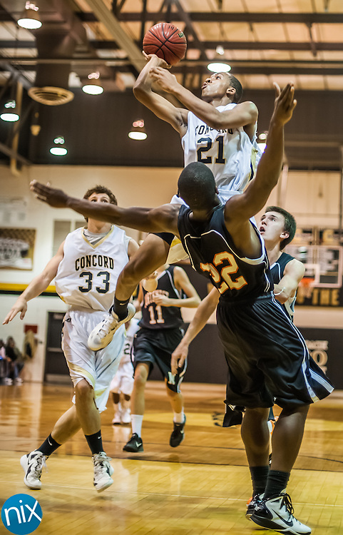 Concord's Keenan Black goes up for a shot against Northwest Cabarrus' Christian King Tuesday night at Concord High School. Concord defeated the Trojans 92-80.