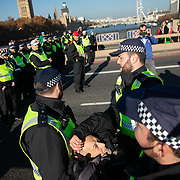 Thousands of Extinction Rebellion activists took over 5 bridges in Central London and blocked them for the day, November 17 2018, Central London, United Kingdom. Lambeth Bridge; an elderly quaker man is arrested and taken away by police. Around 11am people on all bridges sat down in the road and blocked traffic from coming through and stayed till late afternoon. The actvists believe that the government is not doing enough to avoid catastrophic climate change and they demand the government take radical action to save future generations and the planet.Many are willing to be arrested peacefully protesting and up to 80 were arrested on the day.Extinction Rebellion is a grass root climate change group started in 2018 and has gained a huge following of people commited to peaceful protests and who ready to be arrested. Their major concern is that the world is facing catastropohic climate change and they want the British government to act now to save future generations.