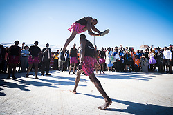 """14 May 2017, Windhoek, Namibia: The Omupembe Cultural Group display a dramatic piece of Namibian culture. The local Namibian hosts offered an """"Ada dâ"""", """"Let's Celebrate"""", after thousands of Lutherans and guests had gathered for a festival of worship, witness and song and word and sacrament in Sam Nujoma Stadium on Sunday, May 14th to mark commemoration of the 500th Anniversary of the Lutheran Reformation in Windhoek, Namibia."""