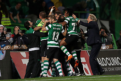 April 18, 2018 - Lisbon, Portugal - Sporting's head coach Jorge Jesus from Portugal (R ) celebrates the victory with the players after the Portugal Cup semifinal second leg football match Sporting CP vs FC Porto at the Alvalade stadium in Lisbon on April 18, 2018. (Credit Image: © Pedro Fiuza via ZUMA Wire)