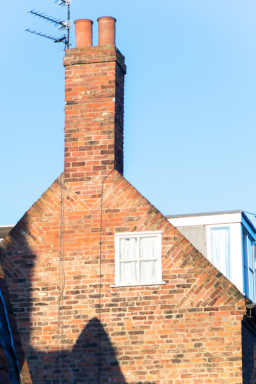Brick tumbled gable with gable chimney and dormer window in Beverley, Yorkshire UK