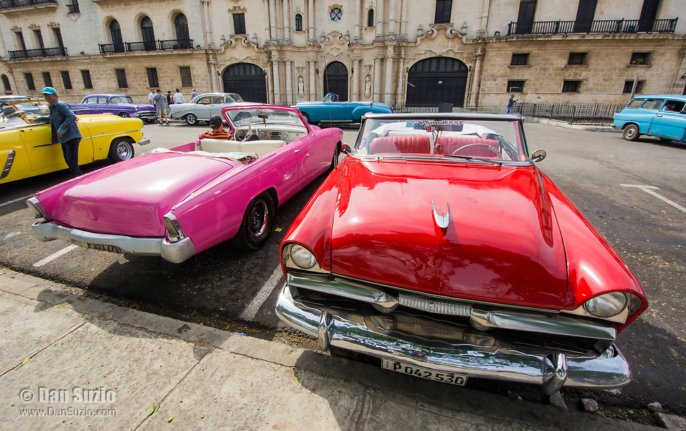 Havana, Cuba - Taxis wait for fares near Plaza de la Catedral. Classic American cars from the 1950s, imported before the U.S. embargo, are commonly used as taxis in Havana.