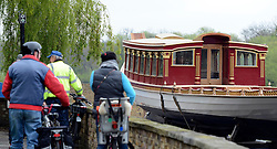 © Licensed to London News Pictures. 19/04/2012. London, UK .People stop to look at the barge. The Royal barge Gloriana is prepared for lowering into the River Thames today for the first time. Gloriana was designed to resemble vessels in Canaletto's famous painting of an 18th century river pageant on the Thames Gloriana will be rowed by eighteen oarsmen, including Britain's Olympian Sir Steven Redgrave. It will lead a pageant of more than 1,000 boats will sail down the Thames on June 3 to mark the 60th anniversary of Her Majesty's reign . Photo credit : Stephen Simpson/LNP