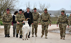 © Licensed to London News Pictures. 09/03/2012. Copedown Hill, UK. Lance Cpl Taffi the goat interrupts the arrival. (Left to right) David Richards (black hat), Chief of Defence Staff, Philip Hammond (dark clothing), Secretary of Defence and Brigadier Doug Chalmers (second from right).  Secretary of Defence Philip Hammond visits troops who are being deployed to Afghanistan next month. The 12thMechanized Brigade (12 Mech Bde) at Copehill Down, Salisbury Plain Training Area, Wiltshire,on FRIDAY 09 MARCH 2012, as it prepares to deploy to Helmand Province, Afghanistan, on Operation Herrick 16, in the Spring of this year. The Brigade were performing a dynamic demonstration of combined Afghan/ISAF operations supported by surveillance assets and casualty evacuation capability. Tornado GR4 fast jest ground support was also displayed.. Photo credit : Stephen SImpson/LNP