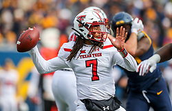 Nov 9, 2019; Morgantown, WV, USA; Texas Tech Red Raiders quarterback Jett Duffey (7) throws a pass during the first quarter against the West Virginia Mountaineers at Mountaineer Field at Milan Puskar Stadium. Mandatory Credit: Ben Queen-USA TODAY Sports