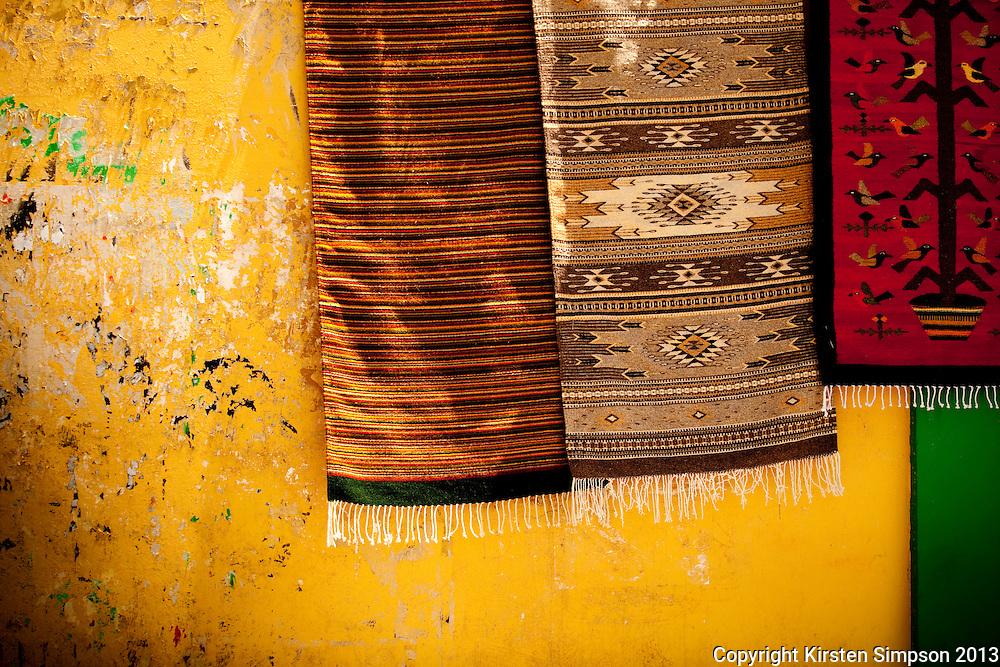 Selling rugs on Plaza Domingo