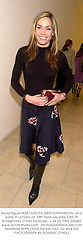 Social figure MISS TARA PALMER-TOMPKINSON, at a party in London on 19th February 2002.	OXS 79