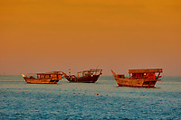 seascape at sunset of the marina harbor with tradional arabic boats
