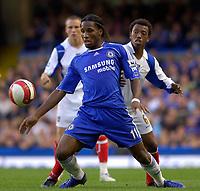 Photo: Daniel Hambury.<br />Chelsea v Portsmouth. The Barclays Premiership. 21/10/2006.<br />Chelsea's Didier Drogba and Portsmouth's Manuel Fernandes battle.