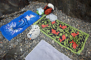 beach towels on gravel in alcove