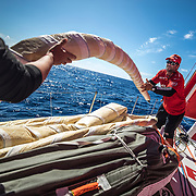 Leg 02, Lisbon to Cape Town, day 13, on board MAPFRE, Pablo Arrarte packing a sail after a pilling. Photo by Ugo Fonolla/Volvo Ocean Race. 17 November, 2017
