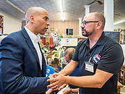 26 JULY 2019 - GREENFIELD, IOWA: Senator CORY BOOKER (D-NJ), left, talks to Dr. GLENN HURST, a family practice doctor in southwest Iowa, about the crisis in rural health care after a campaign event in Greenfield. Sen. Booker is running to be the Democratic nominee for the US Presidency. Iowa traditionally hosts the the first selection event of the presidential election cycle. The Iowa Caucuses will be on Feb. 3, 2020.                          PHOTO BY JACK KURTZ