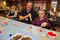 Volunteer Coordinator Randy MacDonald is ready to play a game of BINGO with Marcelle Smith on Tuesday afternoon at the Belknap County Nursing Home.  (Karen Bobotas/for the Laconia Daily Sun)