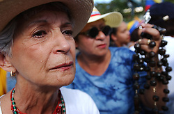 Opposition to President Hugo Chavez march in protest.