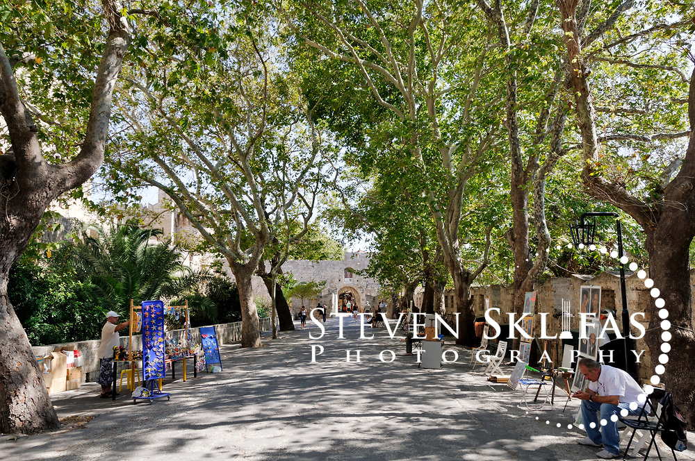 Rhodes. Greece. Plane tree shaded area between St Anthony's gate and d' Amboise Gate inside the medieval Old town of Rhodes. The old town is a UNESCO world heritage listed site and the best preserved, oldest and largest living medieval city in Europe.