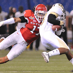 Dec 20, 2009; St. Petersburg, Fla., USA; Rutgers linebacker Damaso Munoz (17) tackles UCF wide receiver Jamar Newsome (9) during NCAA Football action in Rutgers' 45-24 victory over Central Florida in the St. Petersburg Bowl at Tropicana Field.