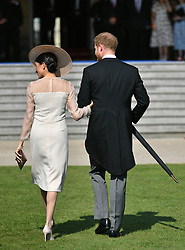 The Duke and Duchess of Sussex at a garden party at Buckingham Palace in London which they are attending as their first royal engagement as a married couple.