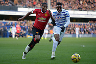 Antonio Valencia of Manchester United and Leroy Fer of QPR chasing the ball. Barclays Premier league match, Queens Park Rangers v Manchester Utd at Loftus Road in London on Saturday 17th Jan 2015. pic by John Patrick Fletcher, Andrew Orchard sports photography.
