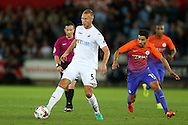 Mike Van der Hoorn of Swansea city in action .EFL Cup. 3rd round match, Swansea city v Manchester city at the Liberty Stadium in Swansea, South Wales on Wednesday 21st September 2016.<br /> pic by  Andrew Orchard, Andrew Orchard sports photography.