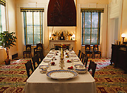 Mahogany and cypress punkah above dining table with original 1850s china from the McMurran family, Dining Room in Melrose, Natchez National Historical Park, Natchez, Mississippi.