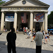 BOSTON, MASS- July 13, 2005:  Visitors in Boston, Massachusetts follow the Freedom Trail to Quincy Market and Faneuil Hall Marketplace on July 13, 2005. (Photo by Todd Bigelow/Aurora)