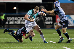 Connacht's Matt Healy breaks the tackle of Cardiff Blues' Garyn Smith<br /> <br /> Photographer Simon King/Replay Images<br /> <br /> Guinness Pro14 Round 9 - Cardiff Blues v Connacht Rugby - Friday 24th November 2017 - Cardiff Arms Park - Cardiff<br /> <br /> World Copyright © 2017 Replay Images. All rights reserved. info@replayimages.co.uk - www.replayimages.co.uk