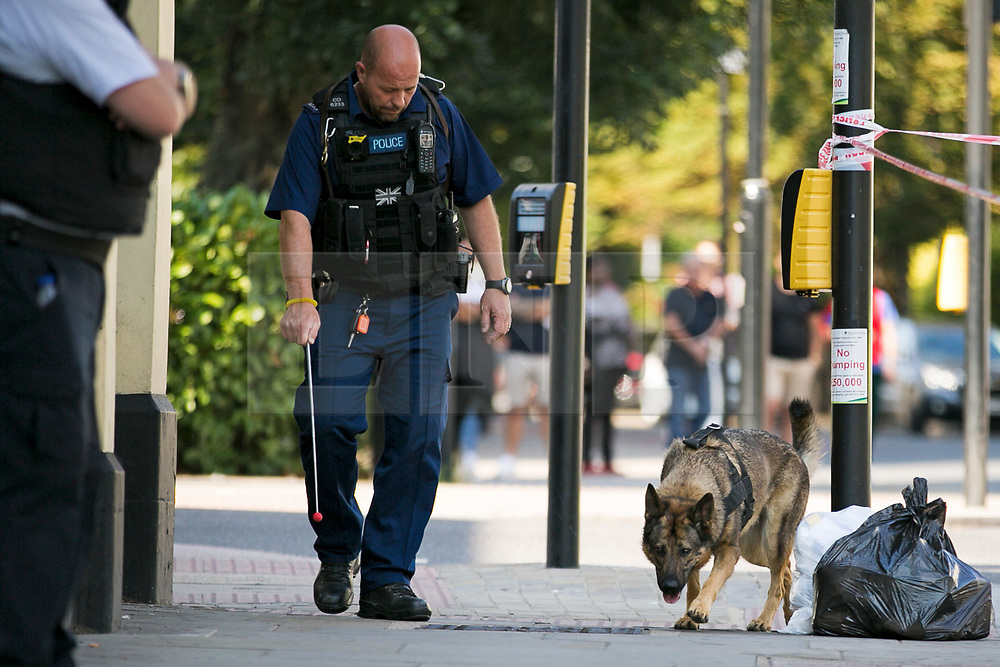 © Licensed to London News Pictures. 01/09/2018. London, UK. Police sniffer dog being used at the Scene on Caledonian Road in London where a woman in her 20's has been stabbed in broad daylight. Police were called to the scene shortly before 10.30am today. Photo credit: Dinendra Haria/LNP