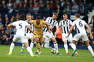 Mousa Dembele of Tottenham Hotspur © looks to go past Gareth McAuley of West Bromwich Albion. Premier league match, West Bromwich Albion v Tottenham Hotspur at the Hawthorns stadium in West Bromwich, Midlands on Saturday 15th October 2016. pic by Andrew Orchard, Andrew Orchard sports photography.