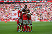 Arsenal's Alexis Sánchez(7) scores a goal 1-0 and celebrates with his team mates during the The FA Cup final match between Arsenal and Chelsea at Wembley Stadium, London, England on 27 May 2017. Photo by Shane Healey.