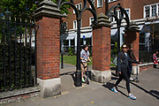 Entrance to Holland Park in Kensington. In a selected few boroughs of West London, wealth has changed over the last couple of decades. Traditionally wealthy parts of town, have developed into new affluent playgrounds of the super rich. With influxes of foreign money in particular from the Middle-East. The UK capital is home to more multimillionaires than any other city in the world according to recent figures. Boasting a staggering 4,224 'ultra-high net worth' residents - people with a net worth of more than $30million, or £19.2million.. London, England, UK.