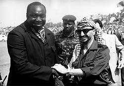 Oct 27, 2004; Kampala, UGANDA; (File Photo. Date Unknown) Arriving at Entebbe Airport to attend the OAU Heads of State Summit, YASSER ARAFAT is greeted by IDI AMIN.   (Credit Image: © Keystone Press Agency/Keystone USA via ZUMAPRESS.com)