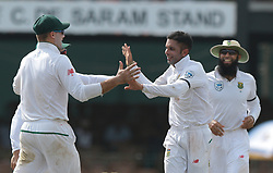 July 19, 2018 - Colombo, Sri Lanka - South African cricketer Keshav Maharaj celebrates with his team members during the first day of the 2nd test cricket match between Sri Lanka and South Africa at SSC International Cricket ground, Colombo, Sri Lanka on Friday 20 July 2018  (Credit Image: © Tharaka Basnayaka/NurPhoto via ZUMA Press)
