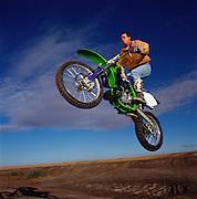Steve Appleton, Chairman and CEO of Micron Technologies jumps his dirt bike outside Boise, Idaho