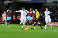 Gylfi Sigurdsson of Swansea city  is challenged by Alex Song of West Ham Utd. Barclays Premier league match, Swansea city v West Ham Utd at the Liberty Stadium in Swansea, South Wales  on Sunday 20th December 2015.<br /> pic by  Andrew Orchard, Andrew Orchard sports photography.