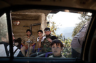 The Free Syrian Army (FSA) at a checkpoint in the village of Adthar, Idlib province, Syria. The area is under opposition control, but government forces remain only three kilometers away. 19/11/2012