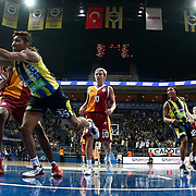 Fenerbahce's Angel MCoughtry (L) and Galatasaray's Isil Alben (C), Sebnem Kimyacioglu (R)during their Turkish Basketball woman league derby match Fenerbahce between Galatasaray at Ulker Sports Arena in Istanbul, Turkey, wednesday, December 26, 2012. Photo by Aykut AKICI/TURKPIX
