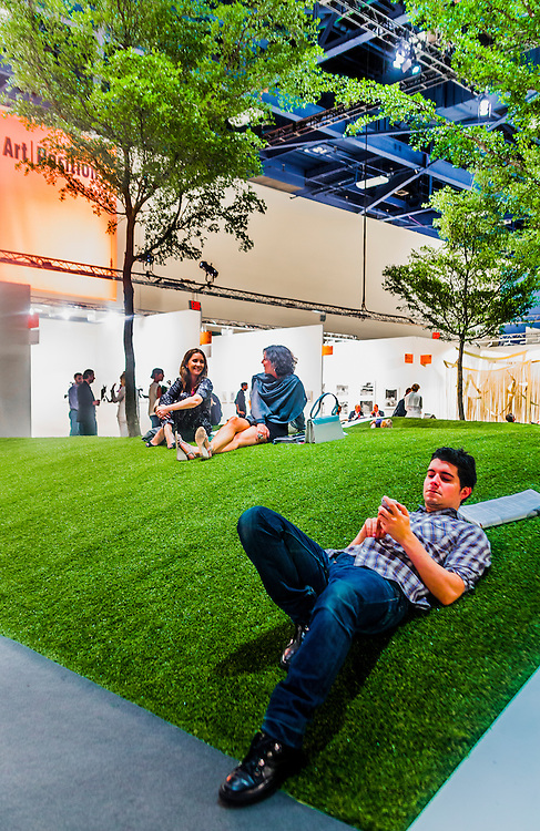 Park with artificial grass and trees inside the Miami Beach Convention Center during Art Basel 2012