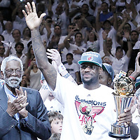 21 June 2012: Miami Heat small forward LeBron James (6) holds the MVP Finals trophy next to Bill Russell after the Miami Heat 121-106 victory over the Oklahoma City Thunder, in Game 5 of the 2012 NBA Finals, at the AmericanAirlinesArena, Miami, Florida, USA. The Miami Heat wins the series 4-1.